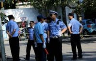 epa05422482 Chinese police officers stand guard at a road block leading up to the Philippines embassy in Beijing, China, 13 July 2016. Heavy security is seen in the area around the Philippines embassy in Beijing after the tribunal at the Permanent Court of Arbitration (PCA) in The Hague ruled on 12 July 2016 against Chinese claims to rights in South China Sea. The PCA declared that a 'nine-dash' line the Chinese government used to delineate South China Sea claims contravenes a United Nations convention on maritime law.  EPA/HOW HWEE YOUNG