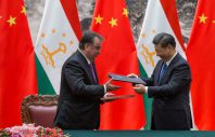 epa06173551 Chinese President Xi Jinping (R) with Tajikistan's President Emomali Rahmon (L) exchange signed document at a ceremony during their meeting at the Great Hall of the People in Beijing, China, 31 August 2017. Rahmon is on a state visit to China from 30 August to 05 September 2017.  EPA-EFE/ROMAN PILIPEY / POOL