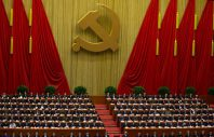 Chinese Communist Party leaders attend  the opening session of 18th Communist Party Congress, while Hu Jintao, no in the picture, Chinese president and current Chinese Communist Party general secretary, reads a work report, whose seat is seen empty in the center of front row, at the Great Hall of the People in Beijing, China, Thursday, Nov. 8, 2012. Preparing to hand over power after a decade in office, China's President Hu Jintao called Thursday for sterner measures to combat official corruption that has stoked public anger while urging the Communist Party to maintain firm political control.  (AP Photo/Alexander F. Yuan)