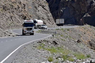 The road Aini - Penjikent. Chinese trucks are going to load.