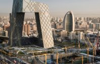 China,Beijing, CCTV tower with construction site in front, showing development.