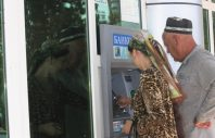 Tajikistan. People withdrawing money from ATMs